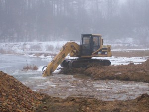 Preparing for the installation of a cranberry bog pump in New Braintree
