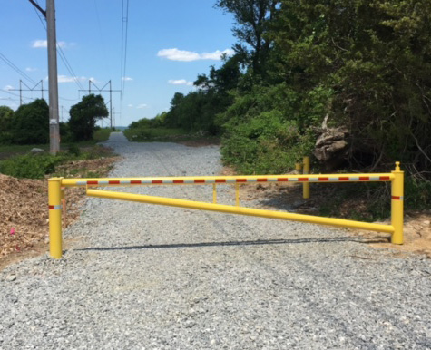 Security Gate, Yellow with red, Standard length is 16' but they can be made 12' to 32' painted any color.